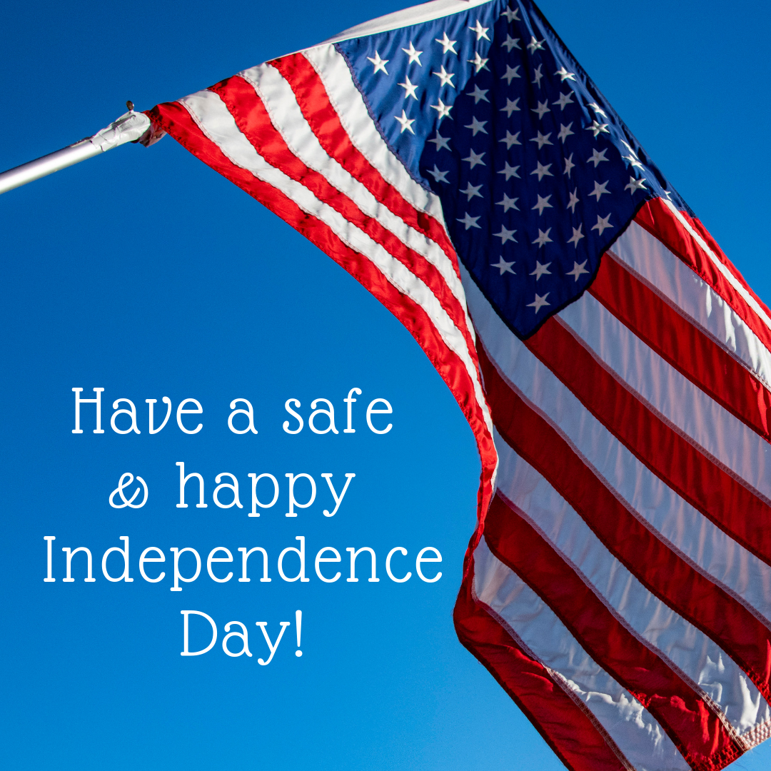 Have a safe and happy Independence Day! over still blue sky background with wind-blown American flag